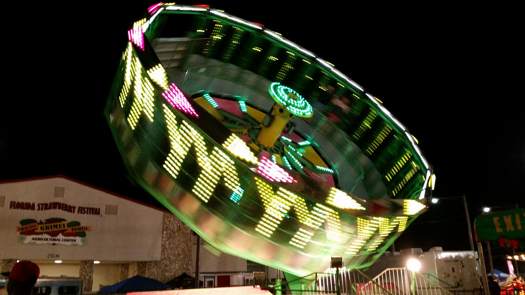 a Whirling Zero Gravity Amusement Park Ride at Night