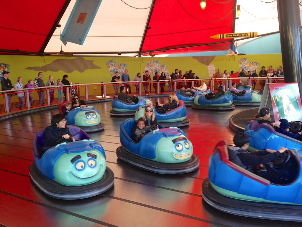 adults and kids enjoying riding bumper cars