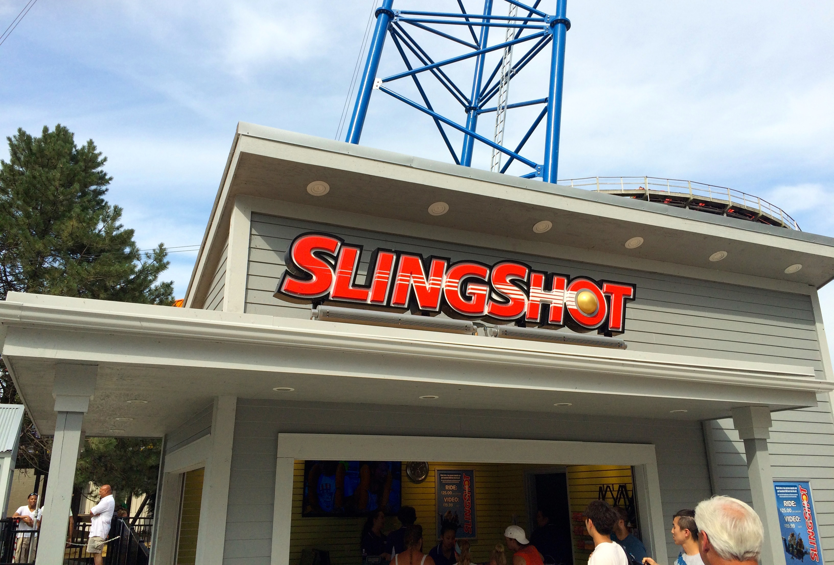 people fall in line to buy a ticket in slingshot booth